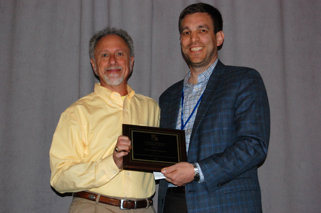 Woody Schwitzer Pictured Accepting On Behalf Of About Campus Magazine